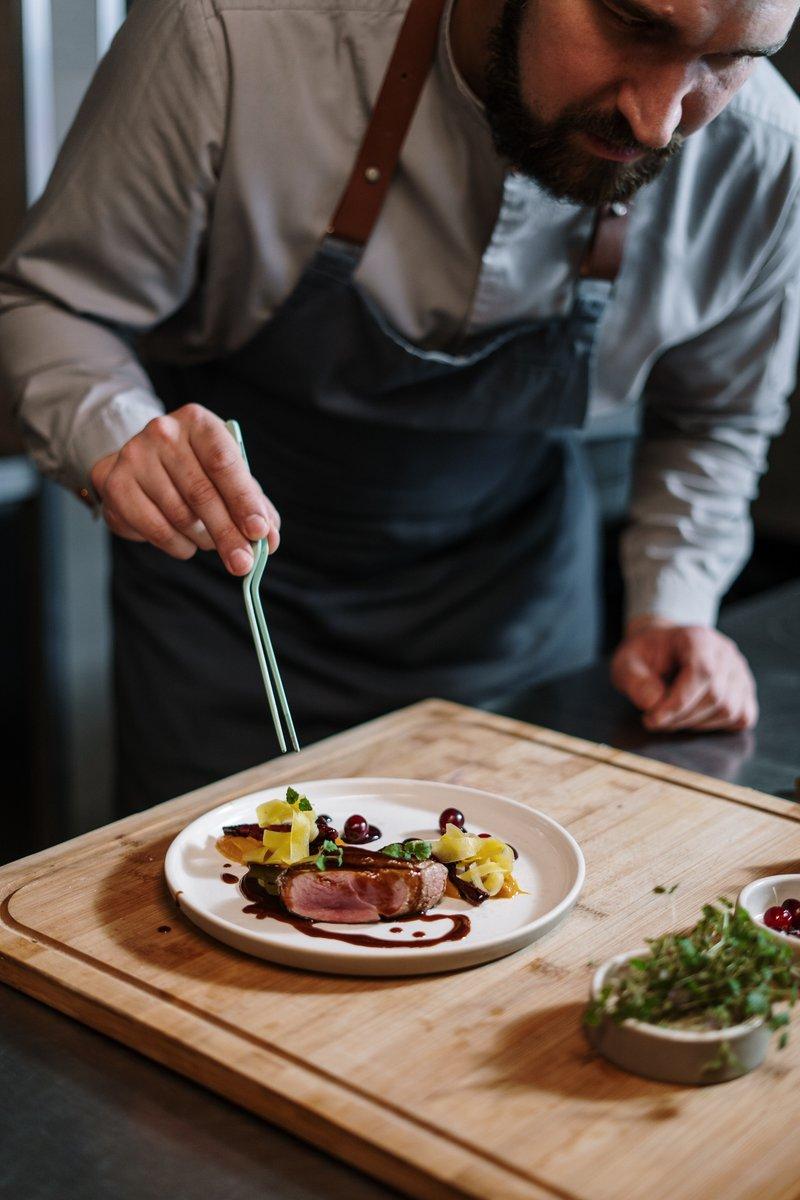 Chef plating food beautifully